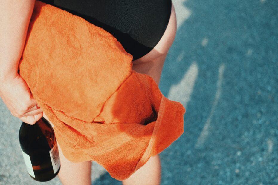 person in black shorts holding orange textile